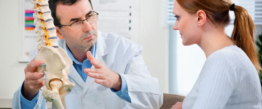 slip disc consultation of a female with male doctor