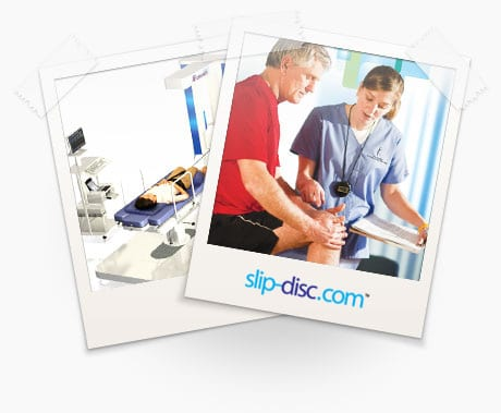 physiotherapists treating symptoms of slip disc in the back